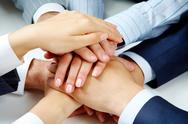 Stock Photo of close –up of business people's hands on top of each other