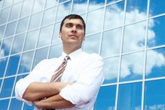 Portrait of confident businessman on background of office building Stock Photos