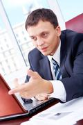portrait of smart businessman during interaction at workplace - stock photo