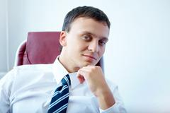 Portrait of confident and successful young businessman Stock Photos