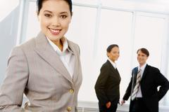 portrait of beautiful businesswoman in suit looking at camera - stock photo