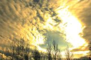 Stock Photo of Golden abstract sky