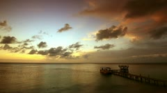Beautiful sunset on the Caribbean coast of the island of Roatan Stock Footage