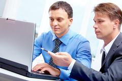 portrait of confident businessman sharing ideas with his partner - stock photo