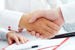 image of handshaking of business partners - stock photo