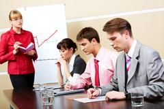image of smart teacher looking at students in workshop - stock photo