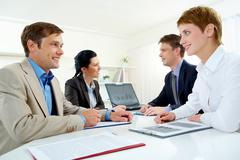 portrait of business people interacting with each other in the boardroom - stock photo