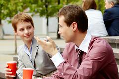Portrait of happy business partners having break outside at summer Stock Photos
