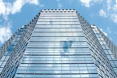 Image of modern office building against cloudy sky Stock Photos