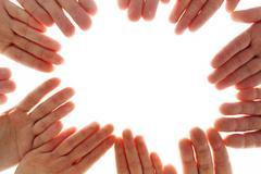 close-up of several human palms making circle - stock photo