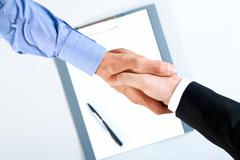 Image of final of deal over paper with pen Stock Photos
