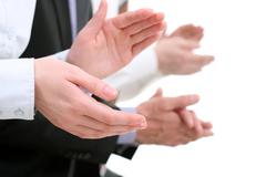 Photo of businesswoman's hands applauding at background of partners Stock Photos