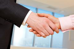 close-up of business handshake of two businesspeople - stock photo