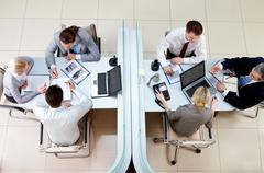 view from above of two business teams working and interacting separated by borde - stock photo
