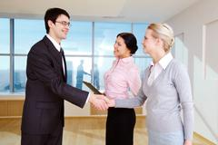Photo of happy partners handshaking after signing contract in office Stock Photos