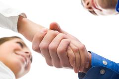 view down of business people handshaking and making agreement - stock photo