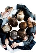 Above view of several business partners embracing each other and making circle Stock Photos