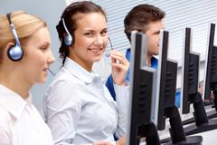 business team of operators sitting at the table during telephone conversation - stock photo