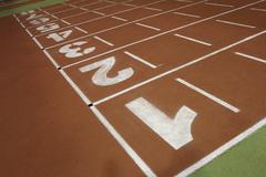 Running track in the athletics gym Stock Photos