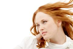 image of beautiful red-haired woman posing to camera - stock photo