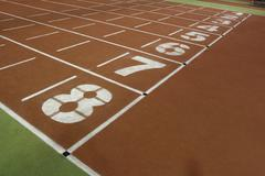 Running track in the athletics gym - stock photo