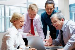 team of four businesspeople planning new project together - stock photo