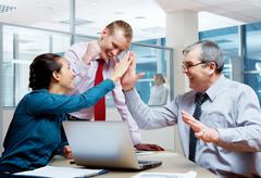 Image of joyful businesspeople congratulating corporate victory Stock Photos