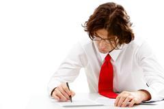 Image of smart business man writing something on document Stock Photos