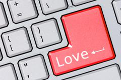 Stock Photo of modern keyboard with love text