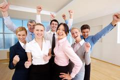 Portrait of successful people raising hands showing gladness Stock Photos