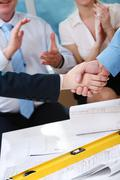 Image of customer and architect handshaking after making an agreement Stock Photos
