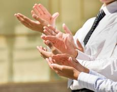 photo of business partners hands applauding at meeting - stock photo