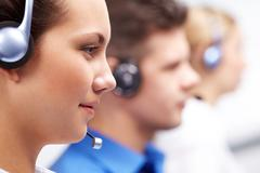Close-up of customer support representative with headset during work Stock Photos