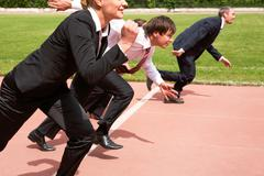 image of active employees running on sport track - stock photo