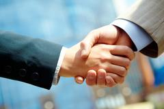 Stock Photo of photo of handshake of business partners after striking deal