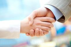 Handshake of business partners after signing contract Stock Photos