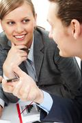 Photo of smart woman looking at her colleague with smile during dialogue Stock Photos