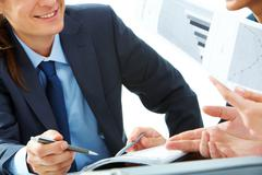 Close-up of smiling businessman during communicating with partners Stock Photos