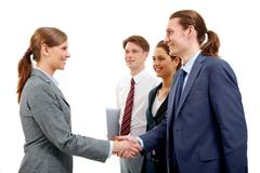 Photo of successful partners handshaking after signing contract Stock Photos