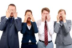 row of business partners closing their eyes by hands and smiling - stock photo