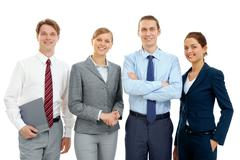 photo of several successful associates looking at camera - stock photo