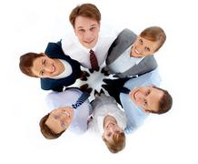 above view of several successful associates looking at camera while embracing ea - stock photo
