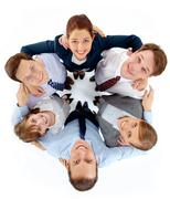 above view of circle of successful associates looking at camera with smiles - stock photo