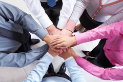 Close-up of business people standing and keeping hands on top of each other Stock Photos
