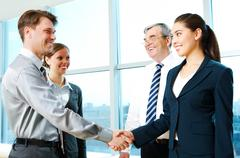 Photo of successful partners handshaking after signing agreement at meeting Stock Photos