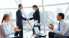Photo of confident partners handshaking at meeting after making an agreement Stock Photos