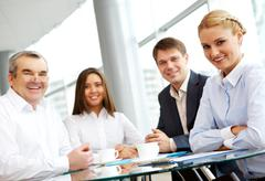 Stock Photo of smiling business group looking at camera