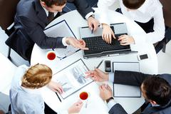 Image of business people hands working with papers and typing at meeting Stock Photos