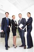 image of confident business team posing in front of camera - stock photo