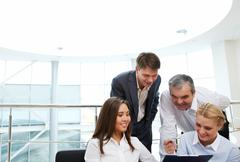Image of confident manager showing plan to colleagues Stock Photos